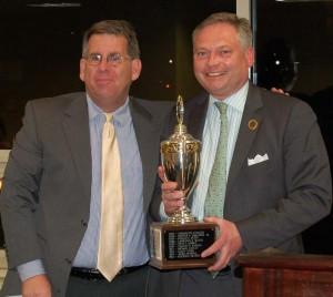 Scott McCaffrey presents the Sun Gazette Cup to ACCF President Michael McMenamin.